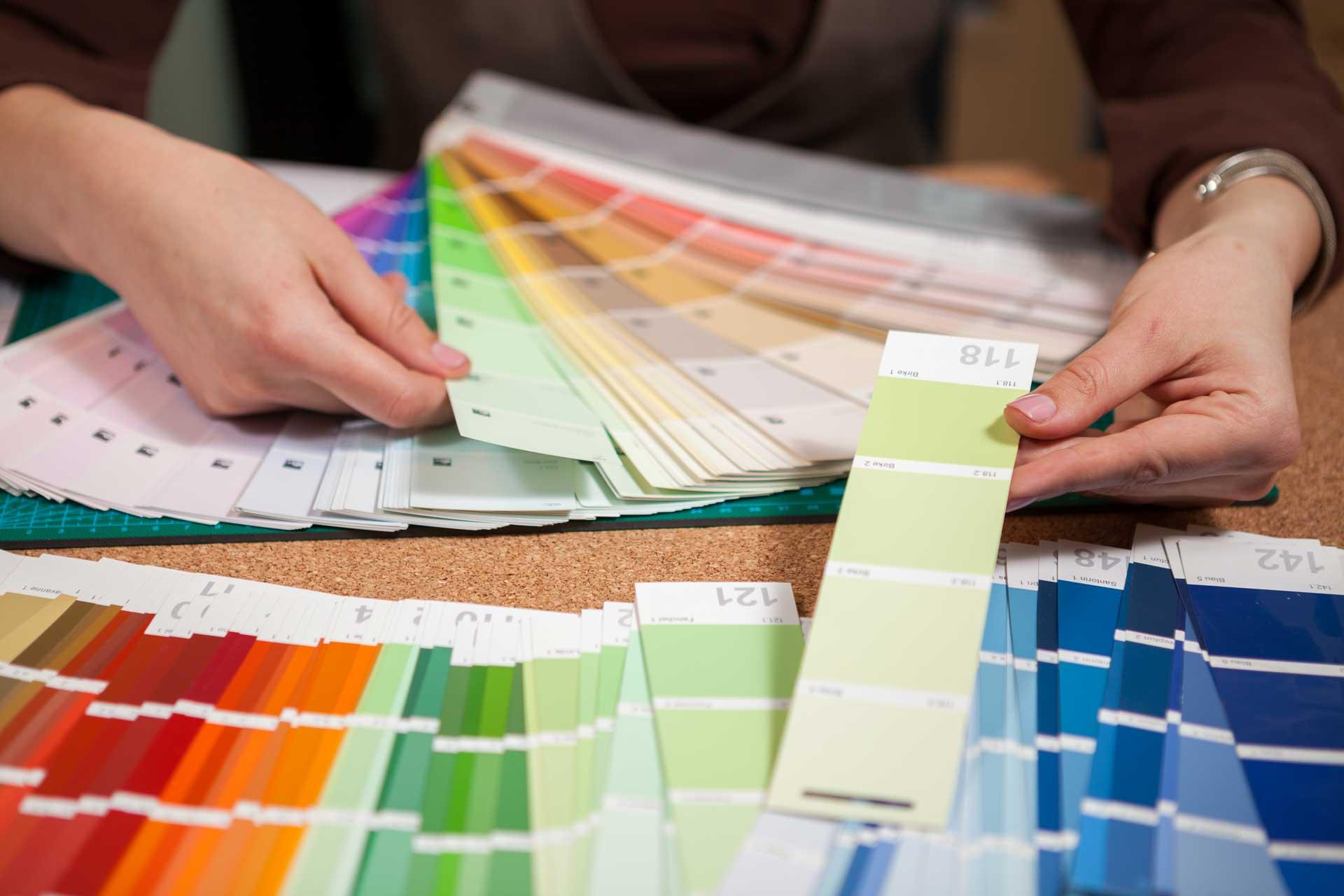 close-up-image-of-color-cards-on-architect-desk-PDTDP7N.jpg